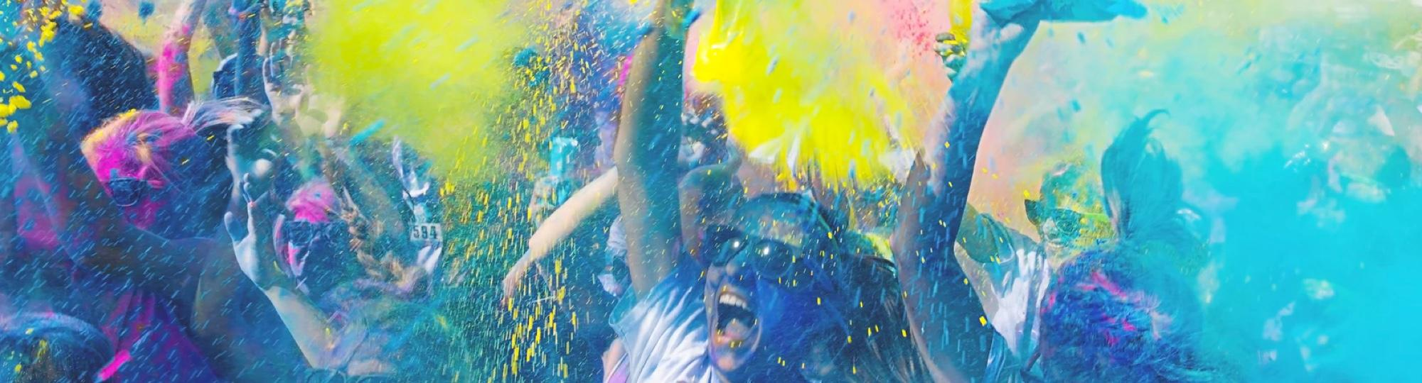 people running through color bomb