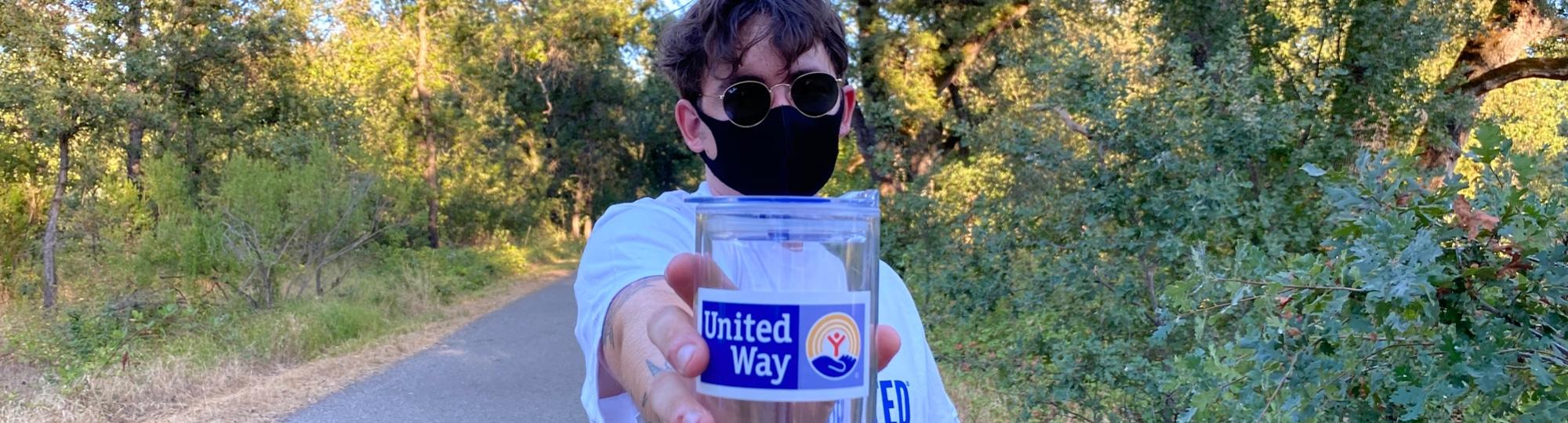 Man holding United Way Cup