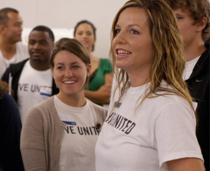 group of people wearing white live united shirts